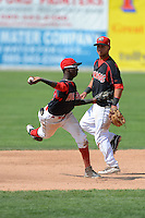 Batavia Muckdogs shortstop Javier Lopez (35) attempts to turn a double play as Luis Ortiz (26) looks on during a game against the Aberdeen Ironbirds on August 11, 2013 at Dwyer Stadium in Batavia, New York.  Batavia defeated Aberdeen 7-3.  (Mike Janes/Four Seam Images)