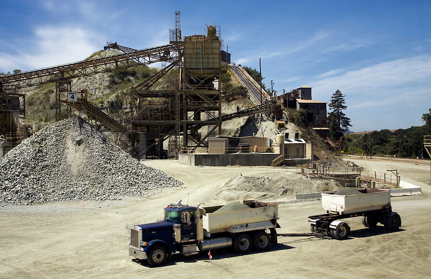CONVEYER BELTS  sorts and delivers ROCK PRODUCTS which are hauled by TRUCKS at GRANITEROCK COMPANY  - AROMAS, CALIFORNIA