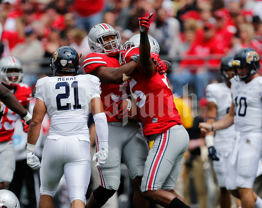 Ohio State Buckeyes linebacker Joshua Perry (37) and Ohio State Buckeyes safety Chris Worley (35) after Worley recovered a fumble  during a football game between The Ohio State University Buckeyes and the Kent State University Golden Flashes on Saturday, September 13, 2014 at Ohio Stadium in Columbus, Ohio. (Columbus Dispatch photo by Fred Squillante)