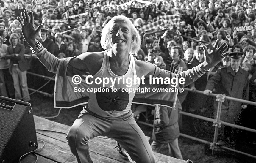 Jimmy Savile performs at a Pop for Peace Concert at Crawfordsburn Country Park, Co Down, N Ireland, November 1976. 197611130449d<br />