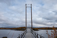 Wooden suspension bridge between islands on lake Tärnasjön, Kungsleden trail, Lapland, Sweden,