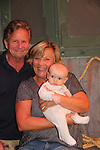 After the show on Sept. 26, 2018 grandparents AC Weary and Kim Zimmer pose with their grandson Vincent Allen Wychules - Guiding Light and OLTL's Kim Zimmer stars in The Shuck  at the Cape May Stage in Cape May, New Jersey. (Photo by Sue Coflin/Max Photo)