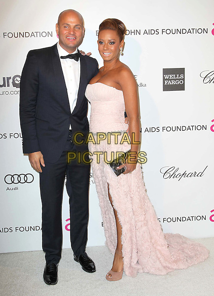 Stephen Belafonte & Melanie Brown aka Mel B.21st Annual Elton John Academy Awards Viewing Party held at West Hollywood Park, West Hollywood, California, USA..February 24th, 2013.oscars full length black tuxedo white silver belt shirt pink strapless dress feathers slit split train clutch bag gold married husband wife.CAP/ADM/KB.©Kevan Brooks/AdMedia/Capital Pictures.
