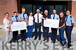 Two cheques being presented by An Garda Tralee and Killarney to the Cork/Kerry Cancer Link Bus and Kerry Mountain rescue in Tralee on Monday. <br /> L-r, Breda Dyland, Gda Ailish Cronin, Gda Linda Brosnan, Trish Kelly, Chief Supt Tom Myers, Mick Long, Gda Gillian MacEoin, Jimmy Laide, Gda Mike Milner.