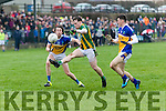 Brian Rayel, Lispole, kicks a score despite the attentions of Darragh O'Reilly and Peter Ahern, Ballyhooly, during their sides clash in the Munster Junior B club football final in Knockaderry