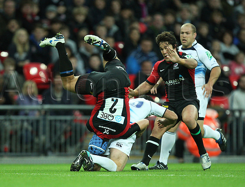 16.10.2010 Rob Kearney of Leinster is tackled by Schalk Brits (2) of Saracens during the Heineken Cup Rugby match Saracens v Leinster at Wembley Stadium in London.