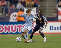 Colorado Rapids midfielder Wells Thompson (15) controls the ball as New England Revolution midfielder Sainey Nyassi (14) defends. The Colorado Rapids defeated the New England Revolution, 2-1, at Gillette Stadium on April 24, 2010.