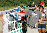 NWA Democrat-Gazette/DAVID GOTTSCHALK   Chas McCoy, education outreach coordinator with the Illinois River Watershed Partnership, reviews the area of a clean up along the Mud Creek Trail and Mud Creek in Fayetteville with University of Arkansas R.O.C.K. Camp participants Wednesday, August 12, 2015. R.O.C.K. Camp, Razorback Outreach for Community and Knowledge, is an extended orientation program for first year students  designed to aid incoming students in developing a diverse social network.