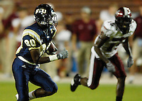 Florida International University Golden Panthers (0-5, 0-1 SBC)  versus the Troy University Trojans (3-2, 2-0 SBC) at the Orange Bowl, Miami, Florida on Saturday, October 6, 2007.  The Trojans defeated the Golden Panthers, 34-16...FIU freshman wide receiver Jason Frierson (80) (Miami, Fla.) takes a Wayne Younger pass 37 yards in the first quarter to set up the Golden Panther's first touchdown of the game.
