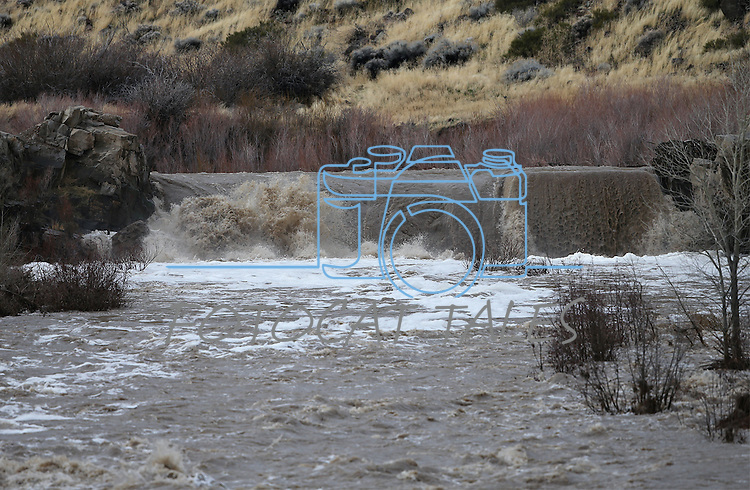 Water flows over the old power dam on the East Fork of the Carson River, in Gardnerville, Nev. on Monday, Jan. 9, 2017. <br /> Photo by Cathleen Allison/Nevada Photo Source