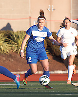 Boston Breakers forward Katie Schoepfer (12) works to clear ball. In a National Women's Soccer League Elite (NWSL) match, the Boston Breakers (blue) tied the Washington Spirit (white), 1-1, at Dilboy Stadium on April 14, 2012.