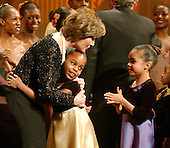 Washington, D.C. - February 6, 2006 -- First lady Laura Bush hugs a young member of the Dance Theatre of Harlem after their performance at the White House in Washington, D.C. on February 6, 2006.<br /> Credit: Ron Sachs / CNP