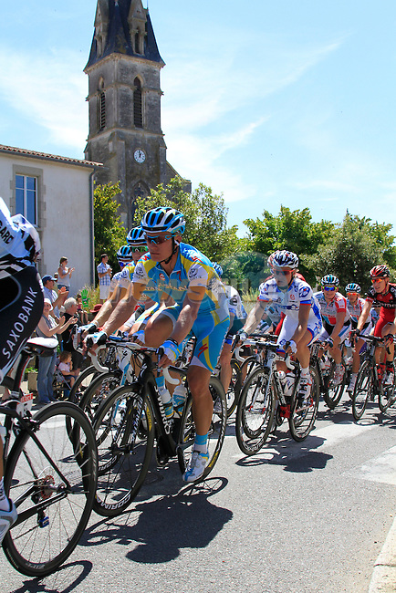 The pelethon including Astana's Alexandre Vinokourov (KAZ) pass through the town of Vaire during the 3rd Stage of the 2011 Tour de France, 198k from Olonne-sur-Mere to Redon, 4th July 2011 (Photo by Eoin Clarke/NEWSFILE)
