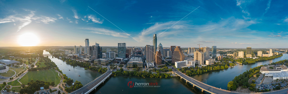 In this Panorama view all roads lead to downtown Austin Skyline, featuring the South 1st Street and Congress Avenue Bridge over Lady Bird Lake. The Austin real estate market is the largest in the state of Texas outpacing both Dallas and Houston resulting in a phenomenal downtown building boom.