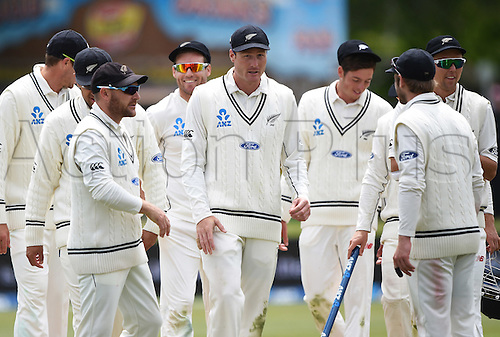 14.12.2015. Dunedin, New Zealand.  Man of the match Martin Guptill leaves the field with team mates as New Zealand win the test match on day 5 of the 1st cricket test match between New Zealand Black Caps and Sri Lanka at University Oval, Dunedin, New Zealand. Monday 14 December 2015.