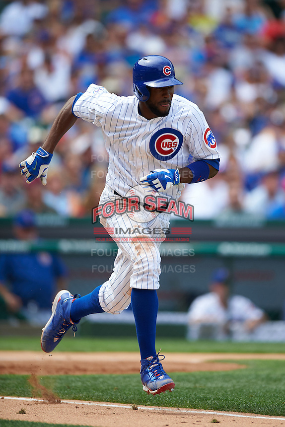 Chicago Cubs outfielder Dexter Fowler (24) runs to first during a game against the Milwaukee Brewers on August 13, 2015 at Wrigley Field in Chicago, Illinois.  Chicago defeated Milwaukee 9-2.  (Mike Janes/Four Seam Images)