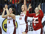 VERMILLION, SD - MARCH 27, 2016 -- Kate Liveringhouse #34, Abigail Fogg #44 and Madeline Homoly on the South Dakota bench celebrate a 3-point basket to extend their lead against Western Kentucky during their WNIT game Sunday evening at the Dakotadome in Vermillion, S.D.  (Photo by Dick Carlson/Inertia)