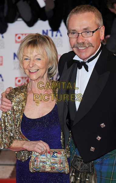 SHEILA REID & GUEST.The 15th National Television Awards held at the O2 Arena, London, England..January 20th, 2010 .NTA NTAs half length gold jacket blue dress sequined sequin trophy shrug bolero .CAP/CJ.©Chris Joseph/Capital Pictures.