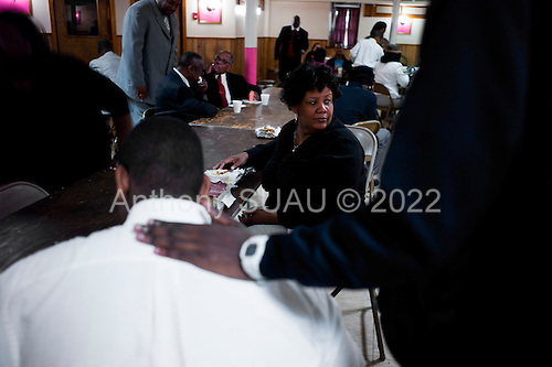 Philadelphia, Pennsylvania<br /> USA<br /> May 22, 2011<br /> <br /> Between services 99er, Rita Calicut, who teaches Sunday school at the First Corinthian Baptist Church Sunday run by Pastor Dennis Earl Thomas, M.Div., lunches with her 14 year old son Kory Calicat-Wayns. Her faith and congregation have given her much needed support over the past two years. ..Rita is a professional fund raiser who previously worked with Multiple Sclerosis Foundation and in higher education.