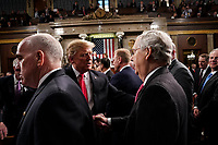 FEBRUARY 5, 2019 - WASHINGTON, DC: President Trump shook hands with Senator Mitch McConnell, R-KY, after the State of the Union at the Capitol in Washington, DC on February 5, 2019. <br /> Credit: Doug Mills / Pool, via CNP