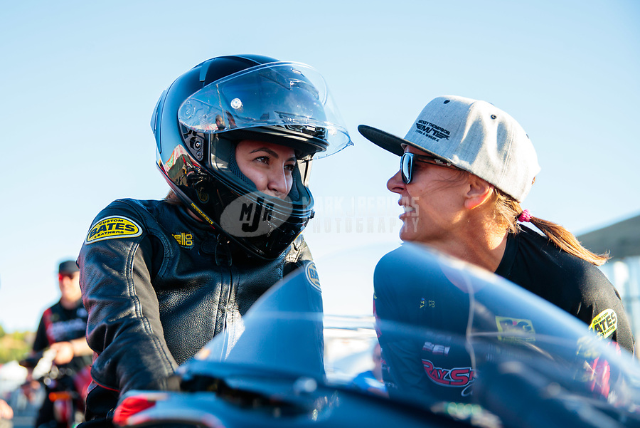 Jul 26, 2019; Sonoma, CA, USA; NHRA pro stock motorcycle rider Jianna Salinas (left) with Karen Stoffer during qualifying for the Sonoma Nationals at Sonoma Raceway. Mandatory Credit: Mark J. Rebilas-USA TODAY Sports