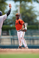 GCL Orioles shortstop Carlos Baez (1) throws to first base during a game against the GCL Rays on July 21, 2017 at Ed Smith Stadium in Sarasota, Florida.  GCL Orioles defeated the GCL Rays 9-0.  (Mike Janes/Four Seam Images)