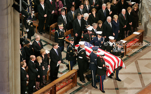 Washington, D.C. - January 2, 2007 --  United States President George W Bush walks past the casket of former U.S. President Gerald R. Ford during funeral services at the National Cathedral in Washington, DC on Tuesday, January 2, 2007. The Ford Family, Including Betty Ford, her sons Mike, Steven, Jack and Daughter Susan sit in the front row on the left and current US President George W. Bush, as well as former Presidents George H.W. Bush, Bill Clinton and Jimmy Carter attended the service.<br /> Credit: Shawn Thew - Pool via CNP