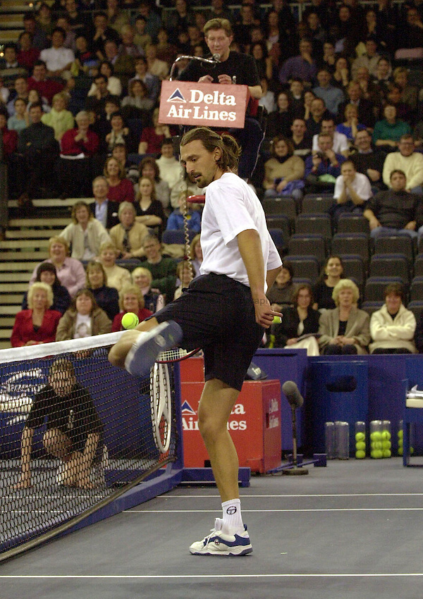 Photo:Ken Brown.20.2.2000 York Tennis Challenge.Goran Ivanisevic gets bored of using his racket