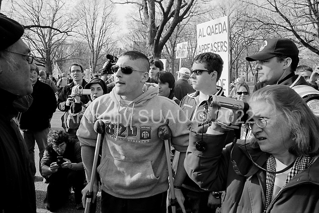 Washington DC.District of Columbia.USA.January 27, 2007..A counter protest to the larger anti-Irai war converged, an yelled slurs at the anti-war protesters. ..There were a few tense moments, including an encounter involving Joshua Sparling, 25, who was in a wheel chair and who said he was a corporal with the 82nd Airborne Division and lost his right leg below the knee in Ramadi, Iraq. Sparling spoke at a smaller rally held earlier in the day at the United States Navy Memorial, and voiced his support for the administration?s policies in Iraq...As anti-war protesters passed he and his group  exchanged words and one of the antiwar protestors spit at the ground just after Sparling made racial slurs at the man, Sparling spit back....