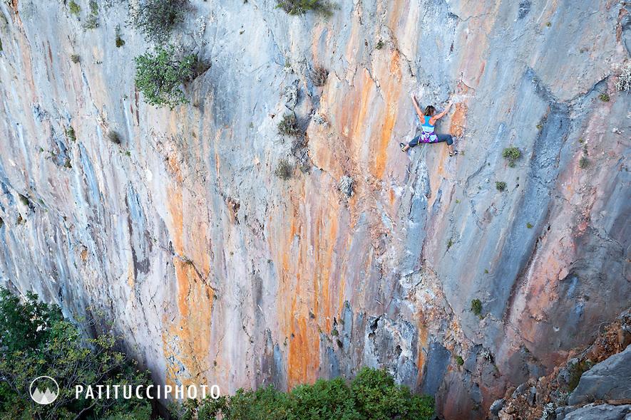 A sport climber on the 7a Cennet Cehennem at Olympos, Turkey