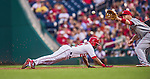20 May 2014: Washington Nationals outfielder Denard Span dives safely back to first during play against the Cincinnati Reds at Nationals Park in Washington, DC. Span tied his career high of going 5 for 5 as the Nationals defeated the Reds 9-4 to take the second game of their 3-game series. Mandatory Credit: Ed Wolfstein Photo *** RAW (NEF) Image File Available ***