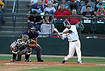 SIOUX FALLS, SD - MAY 17:  Steve Domecus #14 from the Sioux Falls Canaries swings at the ball against the Sioux City Explorers Friday night at the home opener at the Sioux Falls Stadium. (Photo by Dave Eggen/Inertia)