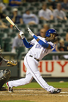 Round Rock second baseman Jurickson Profar (10) follows through on his swing in the Pacific Coast League baseball game against the Nashville Sounds on May 4, 2013 at the Dell Diamond in Round Rock, Texas. Round Rock defeated Nashville -6. (Andrew Woolley/Four Seam Images).