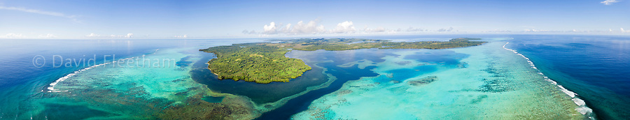 An aerial view above the outer reef and Goofnuw Channel looking south to the island of Yap, Micronesia.