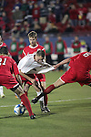 12 December 2008: Casey Townsend (center) of Maryland is pulled off the ball by Joel Gustafsson (6) of St. John's.  The University of Maryland Terrapins defeated the St. John's University Red Storm 1-0 during the second sudden death overtime at Pizza Hut Park in Frisco, TX in an NCAA Division I Men's College Cup semifinal game.