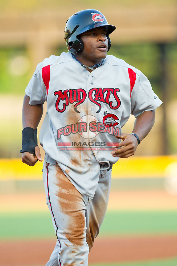 Bryson Myles (23) of the Carolina Mudcats jogs off the field after having been thrown out trying to steal second base against the Winston-Salem Dash at BB&T Ballpark on July 25, 2013 in Winston-Salem, North Carolina.  The Mudcats defeated the Dash 5-4.  (Brian Westerholt/Four Seam Images)
