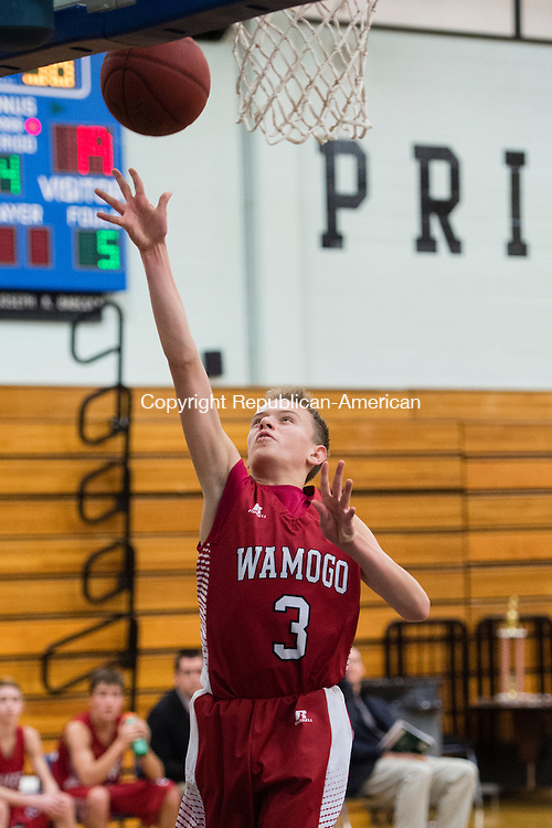 WASHINGTON, CT - 31 December 2015-123115EC07--   Wamogo's Sean Coffey makes two against Wolcott Tech Thursday. The Warriors won, 54-24, at Shepaug Valley High School. Erin Covey Republican-American.