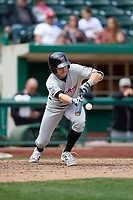 Wisconsin Timber Rattlers left fielder Caleb Whalen (7) lays down a bunt during a game against the Fort Wayne TinCaps on May 10, 2017 at Parkview Field in Fort Wayne, Indiana.  Fort Wayne defeated Wisconsin 3-2.  (Mike Janes/Four Seam Images)
