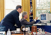 United States President Bill Clinton and US Vice President Al Gore look at a computer during a joint live radio address in the Oval Office of the White House in Washington, DC on Saturday, April 19, 1997.  They spoke on the second national NetDay, which brings citizens from all across America together with the goal of connecting every classroom and library in the US to the internet by the year 2000.<br /> Mandatory Credit: Sharon Farmer / White House via CNP