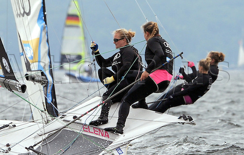 25.06.2013. Kiel-Schilkseel, Germany.  German yachtswomen Victoria Jurczok (FRONT-R) and Anika Lorenz (L) compete in a regatta of Olympic 49er-FX class boats on the Baltic Sea off Kiel-Schilksee, Germany, 25 June 2013. Around 4,500 athletes from more than 50 countries take part in the sailing competitions during Kiel Week.