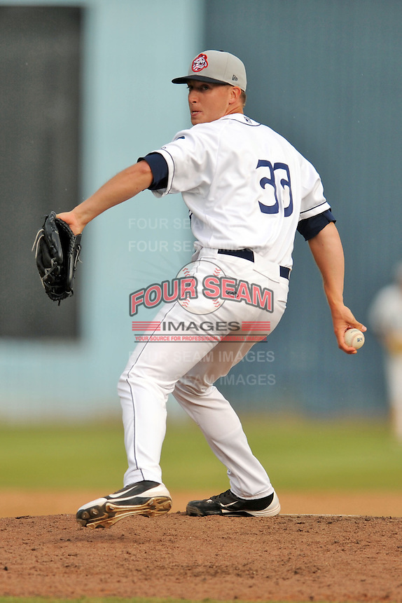 Asheville Tourists pitcher Andrew Brown #33 delivers a pitch during game one of a double header against the Greensboro Grasshoppers on July 2, 2013 in Asheville, North Carolina.  The Tourists won the game 5-3. (Tony Farlow/Four Seam Images)