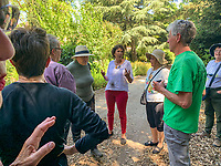 Ximena Nazal Manzur in her garden in Chile giving tour to Hortisexuals from California