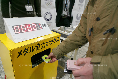 A man donates his old mobile phones to make medals for the 2020 Tokyo Olympic and Paralympic Games at Tokyo Metropolitan Government Building on February 21, 2017, Tokyo, Japan. Tokyo Government has asked for people to donate their old electronic gadgets (including smart phones, mobile phones and tablets) with the aim of collecting and recycling eight tonnes of gold, silver and bronze to make the 5,000 medals needed for the 2020 Tokyo Olympic and Paralympic Games. The recycling campaign started on Thursday, February 16. (Photo by Rodrigo Reyes Marin/AFLO)
