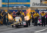 Oct 2, 2016; Mohnton, PA, USA; NHRA top fuel driver Doug Kalitta does a wheelstand as he launches off the starting line during the Dodge Nationals at Maple Grove Raceway. Mandatory Credit: Mark J. Rebilas-USA TODAY Sports