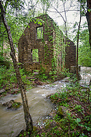 The remains of Mitchell Mill on North Sylamore Creek and water running over the dam at Mirror Lake at the Blanchard Springs Recreation Area in the Ozark National Forest in Arkansas.  Steve Mitchell built his mill on the location of the Mill built by John Blanchard in 1880's.  The dam and part of the mill were restored in the 1940's by the CCC but was never completed.