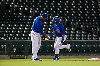 AZL Cubs center fielder Nelson Velazquez (20) is congratulated rounding third base after hitting a home run during the game against the AZL White Sox on August 13, 2017 at Sloan Park in Mesa, Arizona. AZL White Sox defeated the AZL Cubs 7-4. (Zachary Lucy/Four Seam Images)