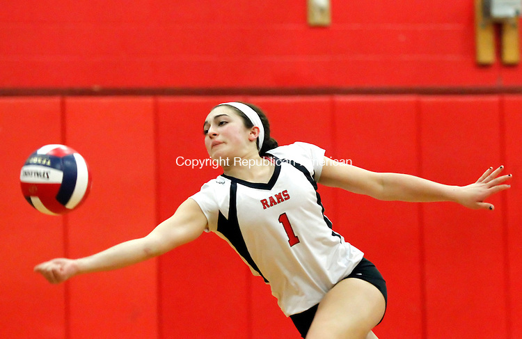 Cheshire, CT-13 November 2012-111312CM07-  Cheshire's Maria Buzzelli  dives for the ball during their 3-1 win over Staples during the Class LL volleyball quarterfinals Tuesday night in Cheshire.   The Rams will face Ludlowe      at Foran High School on Thursday night at 5pm. Christopher Massa Republican-American
