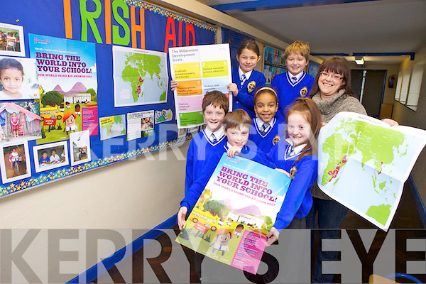 CBS, Tralee pupils Matthew McDonnell, Micheál Forrest, Caoimhe Casey, Jessica Agbaih, Loreta Jahiri and Ronan Clancy with Caroline Kearney from KADE who took part in the Irish Aid Our World Awards 2013 workshops delivered by Kerry One Wold Centre, Tralee