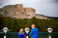 Tourists view the Crazy Horse Memorial from a visitor's center overlook in South Dakota on Sunday, May 21, 2017. (Photo by James Brosher)