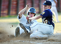 Quakertown's Matt Bukavich slides safely into home as Northern Valley's John Tyler (67) attempts to tag him in the second inning of the Region 2 American Legion Playoffs Tuesday July 19, 2016 at Quakertown Memorial Park in Quakertown, Pennsylvania. Quakertown defeated Northern Valley 13-1. (Photo by William Thomas Cain)